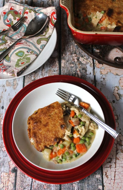 Looking for a Creamy Chicken Pot Pie recipe that isn't full of refined flour? This Chicken Pot Pie with a Whole Wheat Crust has been updated to be a little healthier. But it tastes more like comfort food than anything else that comes out of my kitchen. Double the recipe for an easy freezer meal!!