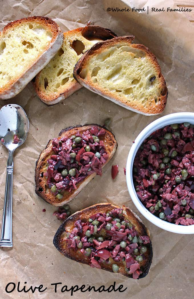 Olive Tapenade is a perfect appetizer for guests or recipe for a light dinner. Assembles in less than 5 minutes. Find more recipes like these at www.wholefoodrealfamilies.com.