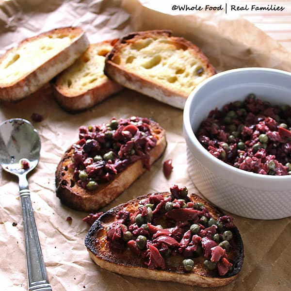 Olive Tapenade is a perfect appetizer for guests or a perfect recipe to go with a light dinner. Only takes 5 minutes to prepare. Get more recipes like this one at www.wholefoodrealfamilies.com.