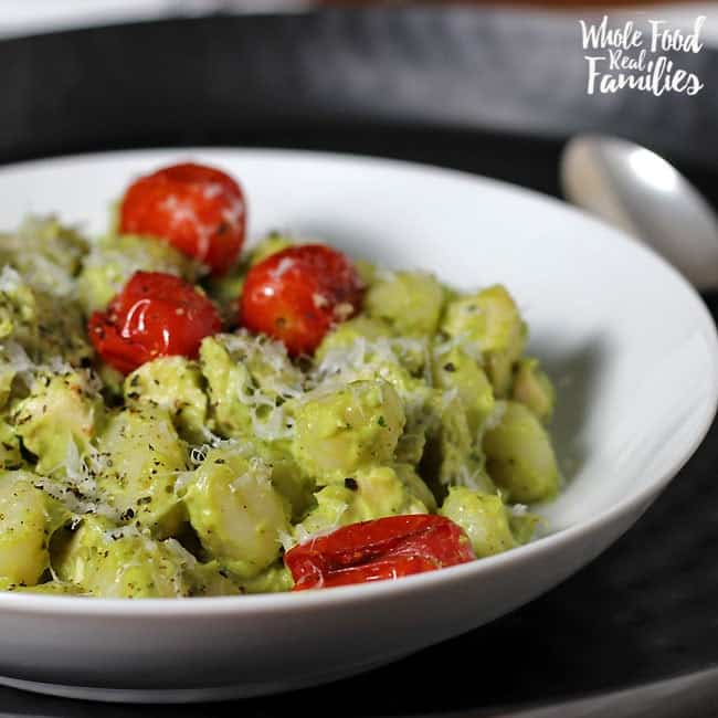 Creamy Avocado Pesto Gnocchi with Roasted Tomatoes is delicious and crazy fast. Perfect for when you are pressed for time but still want to get a real, nourishing meal on the table for your family.