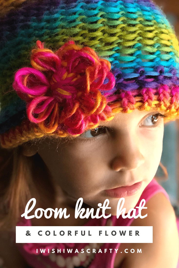 Colorful knit hat with decorative flower you can attach on the brim or the top!
