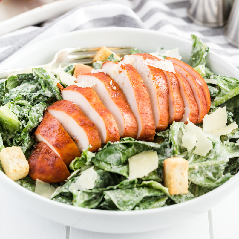 Serve smoked chicken breast over salad