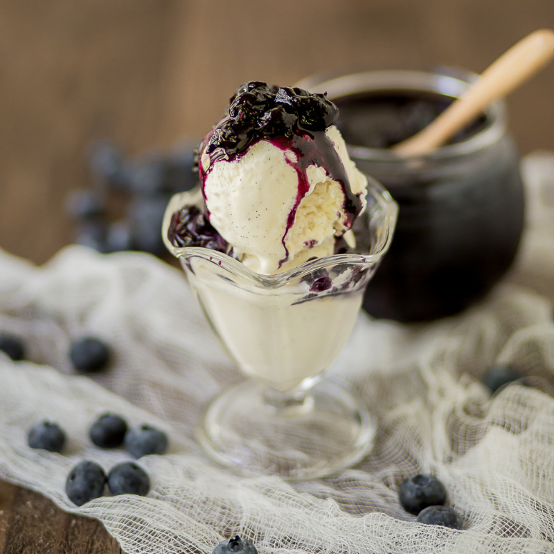 Homemade blueberry compote over ice cream